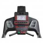 Console screen of the Sole F65 treadmill. The features includes 2 cup holders, multiple button functions, speakers, a mini fan and a tablet holder