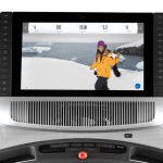 Console screen of the Nordictrack commercial 2950 treadmill. The features includes 2 cup holders, multiple button functions, speakers and a mini fan