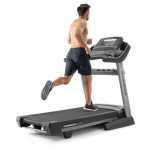 A man in athletic attire running on the Nordictrack commercial 2450 treadmill