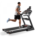 A man in athletic attire running on the Sole F85 treadmill
