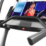 Console screen of the Nordictrack x32i incline trainer with an image of a man conducting a fitness class. The incline trainer features a fan, several buttons, 2 cup holders and a speaker