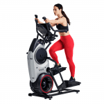 A fit woman in athletic attire working out on the Bowflex Trainer M6