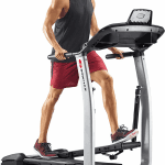 A fit man in athletic attire working out on the Bowflex TC100 TreadClimber
