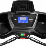 Console of the Bowflex Bowflex TC100 TreadClimber. The features include 2 cup holders, a speaker and several buttons